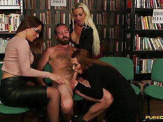 Three oversexed babes band together to suck a gumshoe of one lucky dude