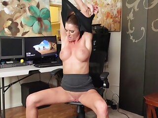 Shaved pussy mature Silvia Saige moans while masturbating on a chair