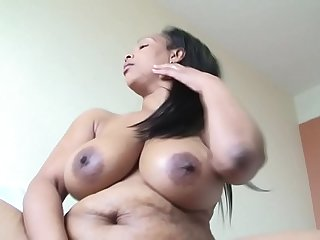 Mature Ebony woman and dildo