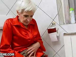 Hairy granny gets fucked by a young stud