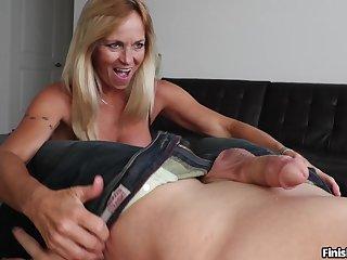 Big fake boobs mature Dani Dare gives a blowjob and a titjob