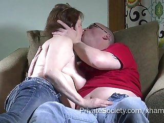 Age-old couple makes love on the sofa in offbeat uniformly