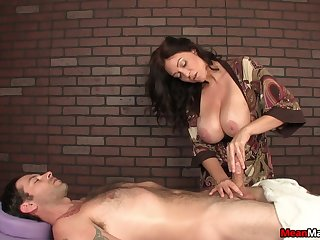 Mature with big boobs plays with dick of her handsome client