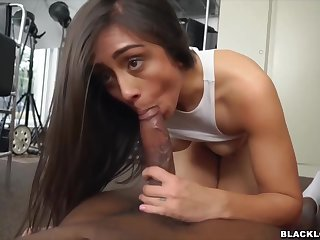 Impassioned brunette is sucking a big, black cock and getting clean out inside her, from the back