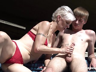 Kinky granny encircling thongs sucks a big lasting penis of one young guy