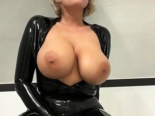Busty amateur milf wears latex uniform and scornful heels